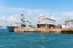 Battleship in harbor Stock Images
