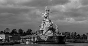 Battleship North Carolina, Wilmington, NC. Storm clouds roll in behind the Battleship North Carolina in Wilmington, NC royalty free stock photography
