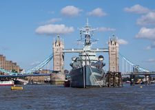Battleship and Tower Bridge Stock Photo