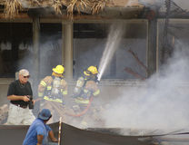 Battling the blaze at Cheeca Lodge Resort. Fire fighters battling the blaze at the Cheeca Lodge Resort in Islamorada Florida Royalty Free Stock Images