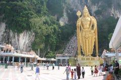 Batu Cave Malaysia. Golden statue of lord muragan outside the batu caves hindu shrine, Malaysia royalty free stock photography