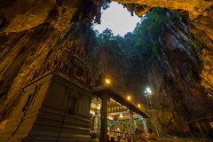 Batu Cave in the Morning. Batu Cave is a Hindu religious temple build into a limestone cavern in Kuala Lumpur Malaysia. This revered religious shrine is home to Stock Photo