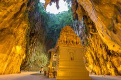 Batu Cave in the Morning. Batu Cave is a Hindu religious temple build into a limestone cavern in Kuala Lumpur Malaysia. This revered religious shrine is home to Royalty Free Stock Photo