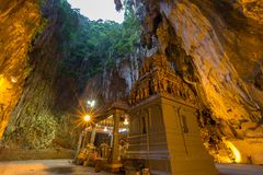 Batu Cave in the Morning. Batu Cave is a Hindu religious temple build into a limestone cavern in Kuala Lumpur Malaysia. This revered religious shrine is home to Stock Photos