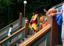 Batu Cave Steps with monks. Batu Cave Steps monks walking down the steps with colorful clothes on Stock Photos