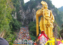 Batu Cave thaipusam 2011 series. BATU CAVE, MALAYSIA - January 20 : Photo of lord murugan statue standing tall in front the cave entrance taken during Thaipusam Stock Images