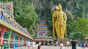 Batu Caves is a limestone hill that has a huge statue of The Lord Murugan Giant located at the entrance of Batu Caves. stock video footage