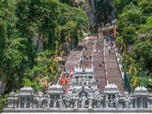 Batu Caves is a limestone hill that has a series of caves and cave temples in Gombak,Malaysia. People can seen exploring around it. Kuala Lumpur, Malaysia Royalty Free Stock Image
