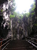 Batu Caves Malaysia. Light pouring in from the top of the cave Stock Photos