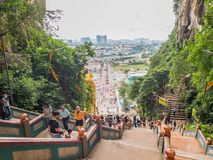 Batu Caves Town from the Top of Stairs Batu Caves Temple. View of Batu Caves Town from the Top of Stairs while tourist walking up and down from the temple Royalty Free Stock Photos