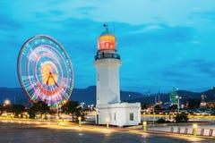 Batumi, Adjara, Georgia Faro di Ferris Wheel In Motion And Pitsunda a passeggiata nel parco di miracolo Fotografie Stock Libere da Diritti