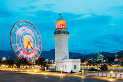 Batumi, Adjara, Georgia Ferris Wheel In Motion And Pitsunda Stockfotos