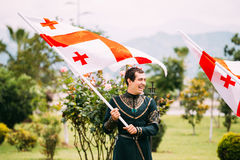 Batumi, Adjara, Georgia - May 26, 2016: Young man in Georgian na. Tional dress holding a national flag in celebration of the national holiday - the Independence Royalty Free Stock Photo