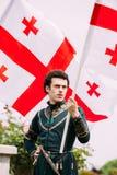 Batumi, Adjara, Georgia - May 26, 2016: Young man in Georgian national flag in celebration Royalty Free Stock Image