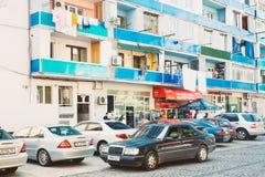 Batumi, Adjara, Georgia. Mercedes Benz Car Parked Near Old Multi. Batumi, Adjara, Georgia - May 25, 2016: Mercedes Benz Car Parked Near Old Multistory House In Royalty Free Stock Photos