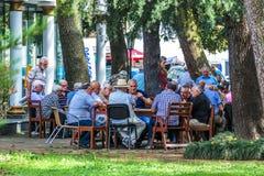 BATUMI, GEORGIA-JULY 9 2015 Georgian men are having fun and playing dominoes Royalty Free Stock Photos
