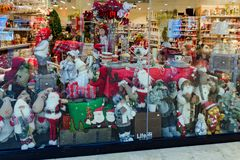 Shop window with New Year items, decor, toys - Santa Claus, bears, teddy, deer. stock image