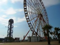Batumi ferris wheel and the Alphabetic tower stock photography