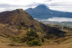 Batur volcano and Agung mountain panoramic view at sunrise from Kintamani Stock Photo