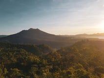 Batur volcano during beautiful sunrise in Bali. Indonesia stock photos