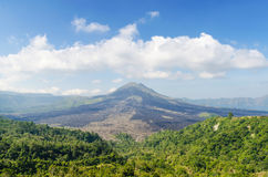 Batur volcano view from kintamani village in bali indonesia. Batur volcano view from kintamani village at noon in bali indonesia Royalty Free Stock Images