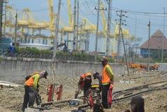 Bau der Semarang-Hafen-Eisenbahn Stockfotografie