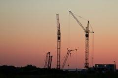 Bau des Hauses bei Sonnenuntergang Lizenzfreies Stockfoto