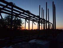 Bau im Sonnenuntergang Lizenzfreie Stockfotos