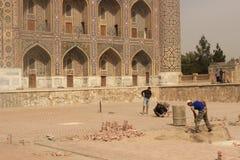 Bauarbeit in Registan Stockbild