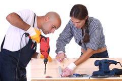 Bauarbeiter bei der Arbeit Lizenzfreie Stockbilder