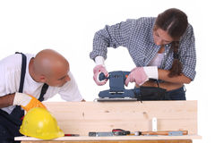 Bauarbeiter bei der Arbeit Stockbilder