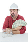 Bauarbeiter, der über das Geld entscheidet Lizenzfreies Stockbild