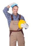 Bauarbeiter, der mit Kopfschmerzen leidet stockfotografie