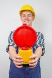 Bauarbeiter mit einer roten Baustandortlampe Stockbilder