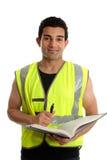 Bauarbeiter mit Feder und Buch stockfotografie