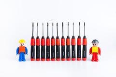 Bauarbeiter mit Satz Schraubenzieher Lizenzfreies Stockbild