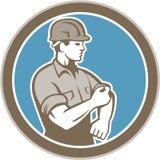 Bauarbeiter-Rolling Up Sleeve-Kreis Retro- Stockfotos