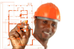 Bauarbeiter Sketching Blueprints lizenzfreie stockfotos