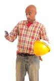 Bauarbeiter am Telefon Stockbild