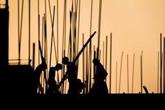Bauarbeiterschattenbild auf der Arbeit Stockfotografie