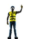 Bauarbeitersignalisieren, das oben Hebemaschinenschattenbild schaut Lizenzfreie Stockfotografie