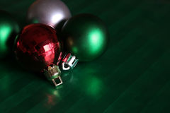 Bauble Collection. A collection of baubles sitting on green wrapping paper Stock Images