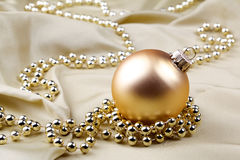Bauble and golden ribbon Royalty Free Stock Images
