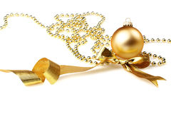 Bauble and golden ribbon Stock Images