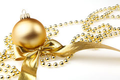 bauble and golden ribbon Royalty Free Stock Photo