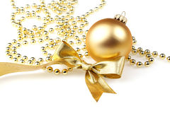 Bauble and golden ribbon Royalty Free Stock Photos