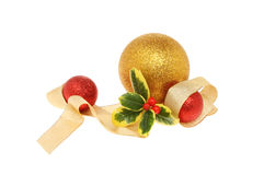 Bauble and holly decoration Stock Images