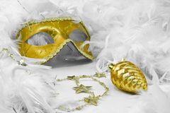 Bauble and mask in feathers boa. Golden mask and bauble in white feathers boa Royalty Free Stock Image