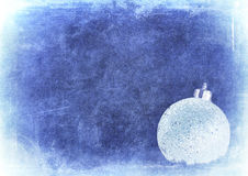 Bauble over grunge texture, christmas background Royalty Free Stock Image