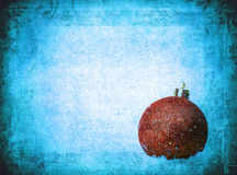 Bauble over grunge texture, christmas background Stock Photo